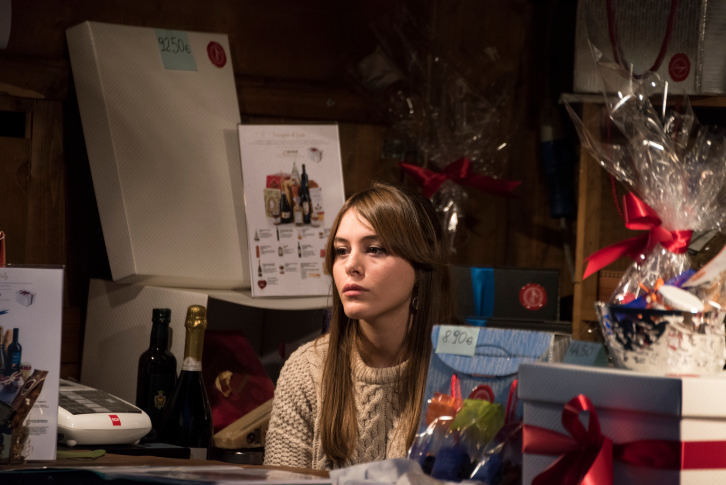Christmas in CItylife, Milan (Lombardy, Italy): a sad girl selling decorations